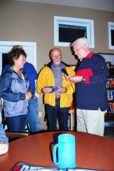 Club's newest members, Teresa And David receive club burgee from Vice Commodore Alan H